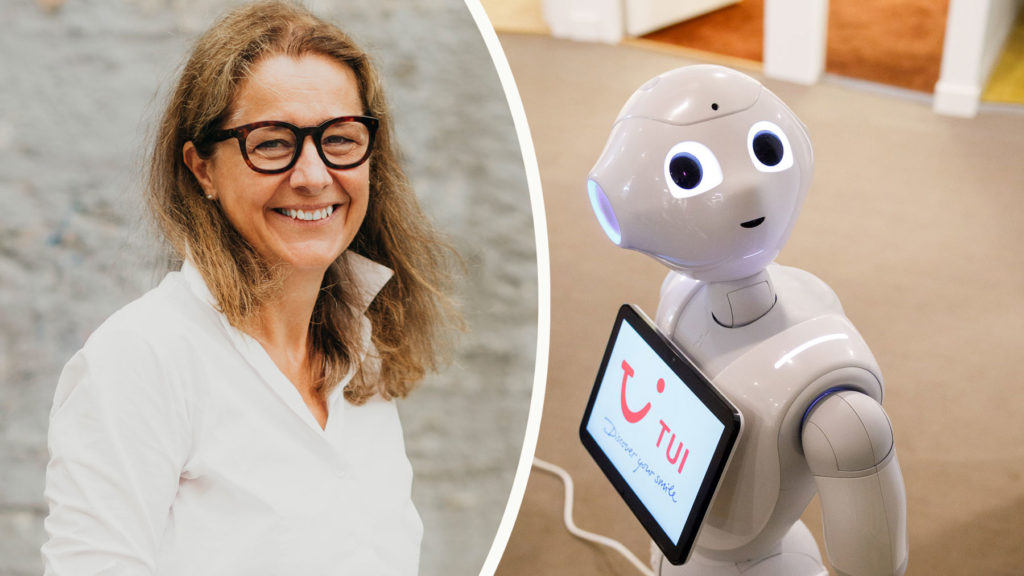 Charlotte WWeibe, HR-direktör på TUI, och roboten Pepper.